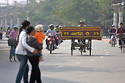 Cyclo transporting a coffin.