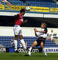 Photo. Glyn Thomas<br />Pre-Season Friendly.<br />Fulham v RCD Mallorca<br />Loftus Road, 10/08/2003<br />Fulham's Junicho Inamoto (R) concentrates as the ball is headed clear.