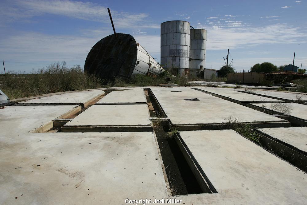 Fallen silos on geometric platform.
