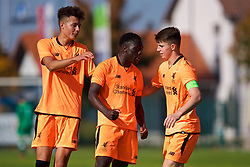 LENDAVA, SLOVENIA - Tuesday, October 17, 2017: Liverpool's Bobby Adekanye [centre] celebrates scoring the fourth goal with team-mates Curtis Jones and captain Ben Woodburn during the UEFA Youth League Group E match between NK Maribor and Liverpool at Športni Park. (Pic by David Rawcliffe/Propaganda)