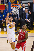 Golden State Warriors guard Klay Thompson (11) takes the ball to the basket against the Houston Rockets during Game 6 of the Western Conference Finals at Oracle Arena in Oakland, Calif., on May 26, 2018. (Stan Olszewski/Special to S.F. Examiner)