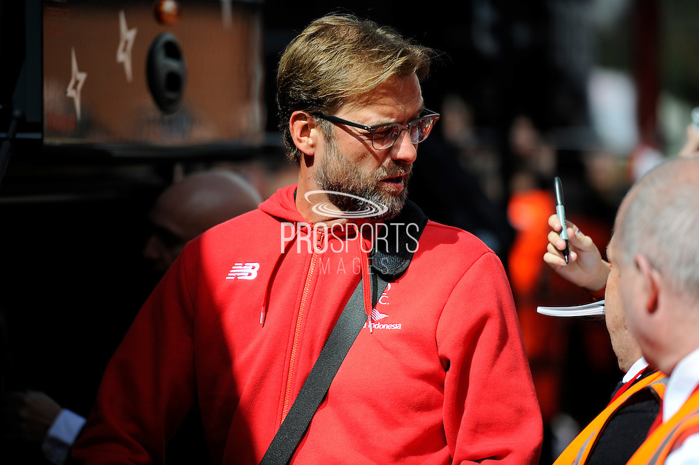 Liverpool manager Jurgen Klopp turns around after being asked for an autographon arrival at the Barclays Premier League match between Bournemouth and Liverpool at the Goldsands Stadium, Bournemouth, England on 17 April 2016. Photo by Graham Hunt.