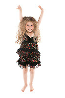 caucasian little girl jumping happy isolated studio on white background