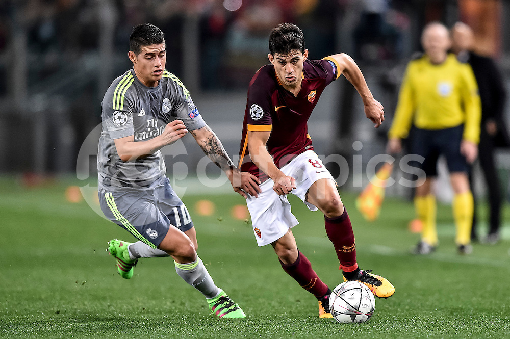 Diego Perotti of Roma is challenged by James Rodriguez of Real Madrid during the UEFA Champions League match between Roma and Real Madrid at Stadio Olimpico, Rome, Italy on 17 February 2016. Photo by Giuseppe Maffia.