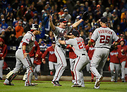 Washington Nationals starting pitcher Max Scherzer, second from left, celebrates his no hitter against the New York Mets with teammates, catcher Wilson Ramos (40), Dan Uggla (26), and Clint Robinson (25) in the second baseball game of a doubleheader, Saturday, Oct. 3, 2015, in New York. The Nationals won 2-0. <br /> (AP Photo/Kathy Kmonicek)