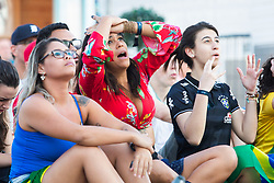 © Licensed to London News Pictures. 06/07/2016. Brighton, UK. Supporters watch the Belgium Vs Brazil World Cup 2018 match on the big screen on the Beach in Brighton and Hove.  Photo credit: Hugo Michiels/LNP