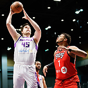 Reno Bighorns Center JACK COOLEY (45) shoots as Raptors 905 Center KENNEDY MEEKS (1) looks on during the NBA G-League Basketball game between the Reno Bighorns and the Raptors 905 at the Reno Events Center in Reno, Nevada.