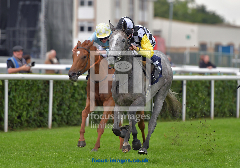 Great White Shark (black and white quartered cap) wins Read Silvestra De Sousa at 188bet Maiden Fillies Stakes at the 188 Bet Summer Afternoon meeting at Doncaster Racecourse, Doncaster<br /> Picture by Martin Lynch/Focus Images Ltd 07501333150<br /> 30/06/2017