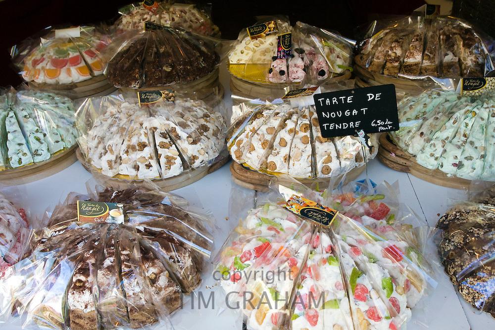 Tarte de Nougat Tendre sweet cakes on sale in Brantome in North Dordogne, France