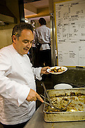 Ferran Adrià, chef of El Bulli restaurant near Rosas on the Costa Brava in Northern Spain dishes himself up some potatoes during the afternoon staff meal.  (Ferran Adrià is featured in the book What I Eat: Around the World in 80 Diets.)