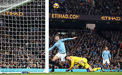 Manchester City's John Stones (left) clears the ball off the line after hitting the ball against goalkeeper Ederson (right) during the Premier League match at the Etihad Stadium, Manchester.