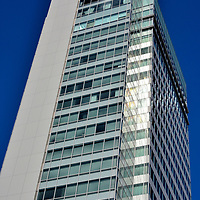 Aoi Tower in Shizuoka, Japan<br /> Shizuoka City's tallest building is Aoi Tower. The blue-glass skyscraper stands 410 feet and was finished in 2010. The high-rise office complex is across the street (Tokai-do) from Shizuoka Station. Aoi-ku is the name of a Shizuoka Prefecture ward encompassing the city.