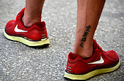Plovdiv BULGARIA.   Ankle [Chinese Script] Tattoo.  2012 FISA Junior and Non Olympic Rowing Championships, Plovdiv Rowing Centre  17:43:04  Tuesday  14/08/2012  [Mandatory Credit; Peter Spurrier: Intersport Images]