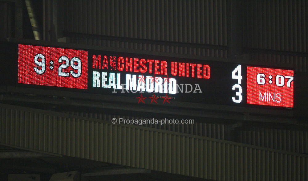 MANCHESTER, ENGLAND - Wednesday, April 23, 2003: The Manchester United score board displays the result against Real Madrid during the UEFA Champions League Quarter Final 2nd Leg match at Old Trafford. (Pic by David Rawcliffe/Propaganda)