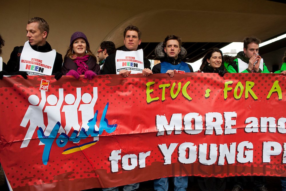 """The European trade Union Confederation (ETUC) said """"No to austerity for everyone and bonuses for a happy few"""". They formed a belt around the European Commission headquarters at the Berlaymont building in Brussels Wednesday 15 December 2010, to symbolise the belt-tightening of austerity. Photo Erik Luntang /INSPIRIT Photo"""