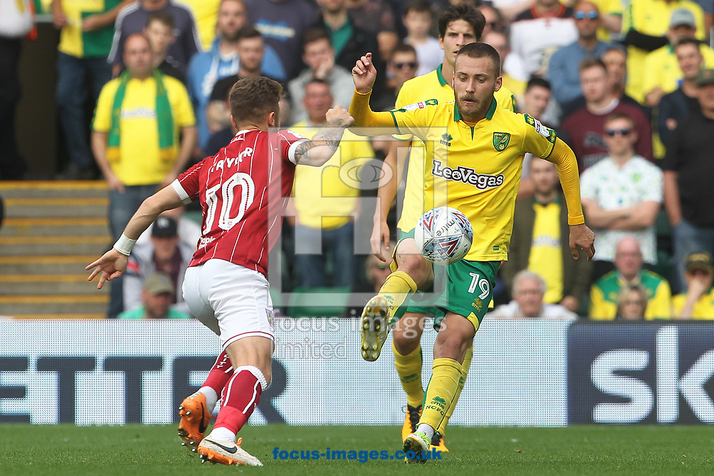 Matty Taylor of Bristol City and Tom Trybull of Norwich in action during the Sky Bet Championship match at Carrow Road, Norwich<br /> Picture by Paul Chesterton/Focus Images Ltd +44 7904 640267<br /> 23/09/2017