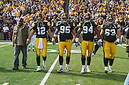 October 23 2010: Former Iowa Hawkeye running back and current New York Jet Shawn Greene, Iowa Hawkeyes quarterback Ricky Stanzi (12), Iowa Hawkeyes defensive tackle Karl Klug (95), Iowa Hawkeyes defensive end Adrian Clayborn (94), and Iowa Hawkeyes offensive linesman Julian Vandervelde (63) walk to the center of the field for the coin toss before the first half of the NCAA football game between the Wisconsin Badgers and the Iowa Hawkeyes at Kinnick Stadium in Iowa City, Iowa on Saturday October 23, 2010. Wisconsin defeated Iowa 31-30.