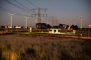 Het geïndustrialiseerde landschap bij Europoort, Haven van Rotterdam. Europoort is een sterk geïndustrialiseerd gebied met petrochemische raffinaderijen, opslagtanks en gespecialiseerde terminals voor de behandeling van ijzer, kolen en voertuigtransporten. Europoort is onderdeel van de haven van Rotterdam, een van 's werelds drukste havens en een belangrijke toegangspoort tot Europa.