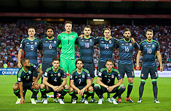 BELGRADE, SERBIA - Sunday, June 11, 2017: Wales players line-up for a team group photograph before the 2018 FIFA World Cup Qualifying Group D match between Wales and Serbia at the Red Star Stadium. Back row L-R: James Chester, captain Ashley Williams, goalkeeper Wayne Hennessey, Sam Vokes, David Edwards, Joe Ledley, Aaron Ramsey. Front row L-R: Ashley 'Jazz' Richards, Ben Davies, Joe Allen, Chris Gunter. (Pic by David Rawcliffe/Propaganda)