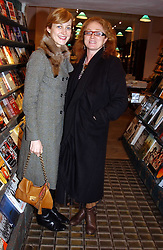 Left to right, RITA KONIG and CAMILLA LOWTHER at a party to celebrate the publication of The new English Kitchen - Changing the Way You Shop, Cook and Eat by Rose Prince held at the Daunt Bookshop, 83 Marylebon High Street, London on 10th March 2005.<br />