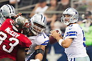 DALLAS, TX - SEPTEMBER 23:  Tony Romo #9 of the Dallas Cowboys looks for a receiver during a game against the Tampa Bay Buccaneers at Cowboys Stadium on September 23, 2012 in Dallas, Texas.  The Cowboys defeated the Buccaneers 16-10.  (Photo by Wesley Hitt/Getty Images) *** Local Caption *** Tony Romo