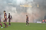 The Bury fans let off a flare during the The FA Cup third round match between Bury and Bradford City at Gigg Lane, Bury, England on 9 January 2016. Photo by Mark Pollitt.