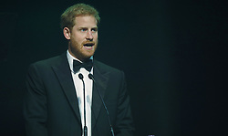 Prince Harry speaks after receiving a posthumous Legacy award on behalf of his mother Diana, Princess of Wales, at the Attitude Awards in London.