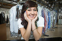 Young smiling woman working in laundrette