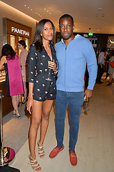ANTHONY ADEBO founderof menswear label Kingdom and ISHA WURIA at a party to celebrate the launch of the new Watches of Switzerland Knightsbridge store 47-51 Brompton Road, London on 7th July 2016.