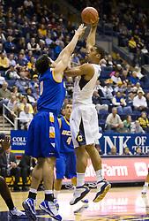 December 29, 2009; Berkeley, CA, USA;  California Golden Bears forward Jamal Boykin (10) shoots over UC Santa Barbara Gauchos forward Jaime Serna (0) during the first half at Haas Pavilion.  California defeated UC Santa Barbara 87-66.