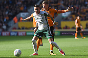 Wolverhampton Wanderers defender Barry Douglas (3) holds up Barnsley midfielder Adam Hammill (7) 0-0 during the EFL Sky Bet Championship match between Wolverhampton Wanderers and Barnsley at Molineux, Wolverhampton, England on 23 September 2017. Photo by Alan Franklin.