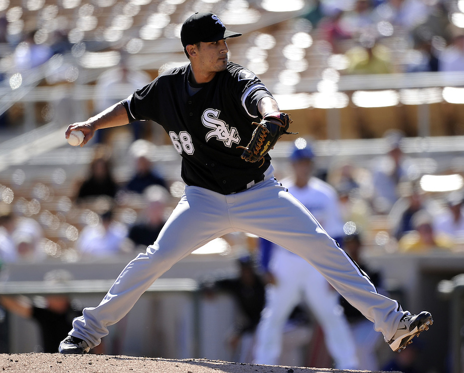 GLENDALE, AZ - FEBRUARY 28:  Miguel Socolovich #68 of the Chicago White Sox pitches against the Los Angeles Dodgers on February 28, 2011 at The Ballpark at Camelback Ranch in Glendale, Arizona.  The Dodgers defeated the White Sox 6-5.  (Photo by Ron Vesely)