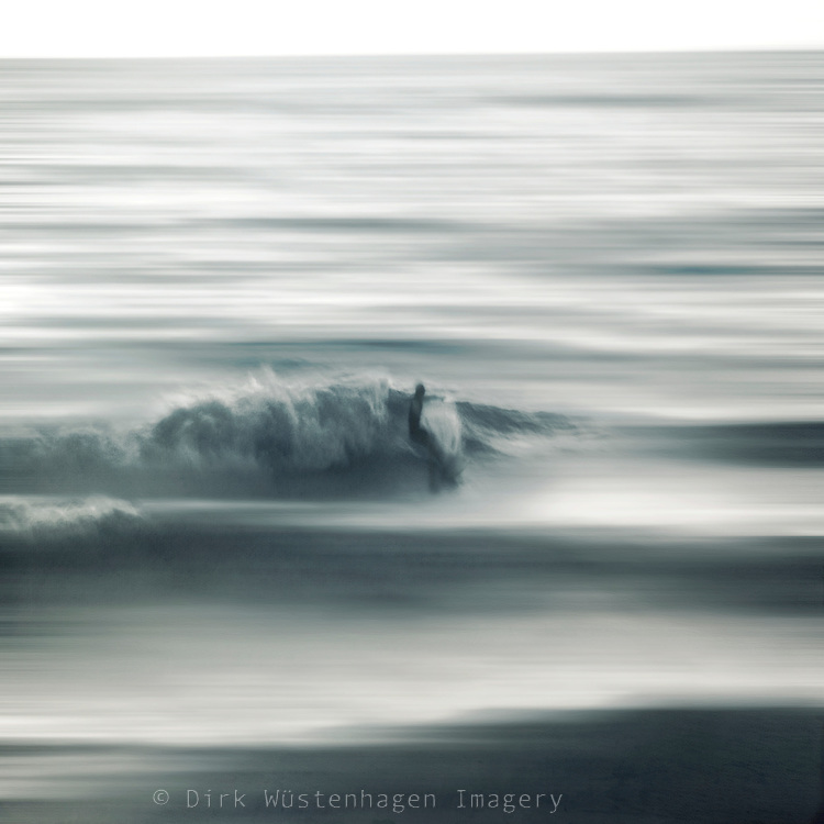 Surfer catching a wave - abstract photography