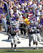 The Kansas State Wildcats roll onto the field lead by Zach Diles (52) and Terry Petrie (26) before playing Marshall, at Bill Snyder Family Stadium in Manhattan, Kansas, September 16, 2006.  The Wildcats beat the Thundering Herd 23-7.