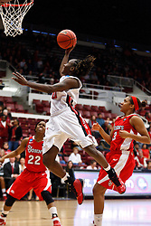 March 19, 2011; Stanford, CA, USA; Texas Tech Lady Raiders guard Chynna Brown (00) shoots past St. John's Red Storm forward Da'Shena Stevens (3) during the first half of the first round of the 2011 NCAA women's basketball tournament at Maples Pavilion. St. John's defeated Texas Tech 55-50.
