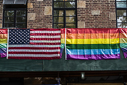 August 6, 2017 - New York City, New York, United States of America - The Pride and American flags hanging together at the historic Stonewall Place in Greenwich Village, NYC. (Credit Image: © Sachelle Babbar via ZUMA Wire)