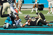 Cam Newton(1) takes it in for the score in the New Orleans Saints 34 to 13 victory over the Carolina Panthers.