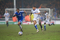 PETERBOROUGH, ENGLAND - Saturday, February 19, 2011: Tranmere Rovers' Joss Labadie and Peterborough United's Mark Little in action during the Football League One match at London Road. (Photo by Gareth Davies/Propaganda)