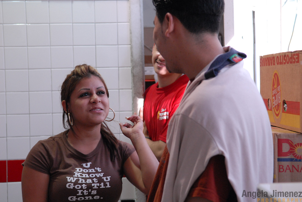 DATE: 6/7/07<br /> DESK: CTY<br /> SLUG: CTOWN<br /> ASSIGN ID: 30044113A<br /> <br /> <br /> Luzmarie Rolon, 17, left, talks with Oseas Santos Lopez, 22, right, who she met when he used to work at the store with her, and another current stockboy at the store, rear, during a break from her cashier shift at Steve's C-Town, a grocery store on 9th Street between 5th and 6th Avenues in Park Slope, Brooklyn on June 7, 2007. <br /> <br /> photo by Angela Jimenez for The New York Times<br /> photographer contact 917-586-0916