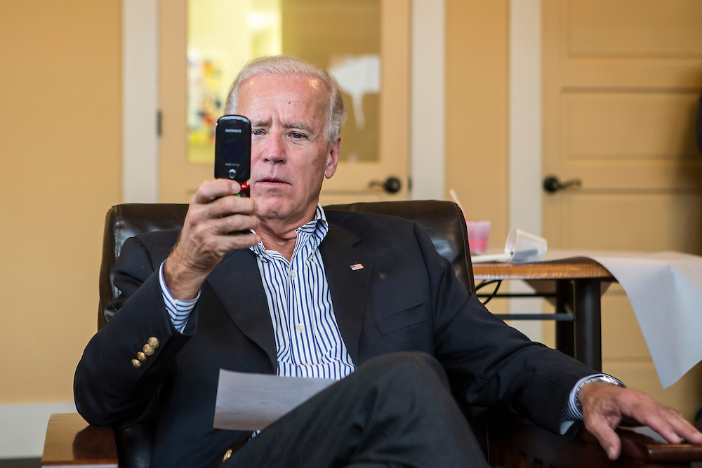 Vice President Joe Biden calls a local resident from a phone banking list during an unscheduled stop at a campaign field office while on a two-day campaign swing through Iowa on Monday, September 17, 2012 in Ottumwa, IA.