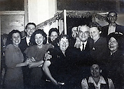 factory and office workers posing with the boss USA 1940s