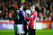 Harry Cornick (14) of Luton Town shoves the ball into the face of Lloyd James (4) of Exeter City during the EFL Sky Bet League 2 match between Exeter City and Luton Town at St James' Park, Exeter, England on 17 October 2017. Photo by Graham Hunt.