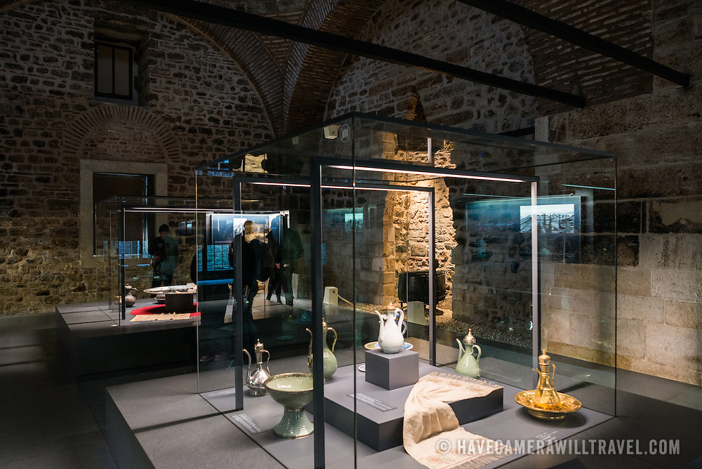 Items on display in exhibits in the former kitchens of Topkapi Palace, Istanbul. The row of massive kitchens that once fed the palace's inahbitants and guests has been converted into museum space displaying some of the tools and utensils used there. On a peninsula overlooking both the Bosphorus Strait and the Golden Horn, Topkapi Palace was the primary residence of the Ottoman sultans for approximately 400 years (1465–1856) of their 624-year reign over Constantinople and the Ottoman Empire. Today it is one of Istanbul's primary tourist attractions.