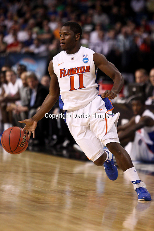 Mar 17, 2011; Tampa, FL, USA; Florida Gators guard Erving Walker (11) during first half of the second round of the 2011 NCAA men's basketball tournament against the UC Santa Barbara Gauchos at the St. Pete Times Forum.  Mandatory Credit: Derick E. Hingle