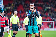 Swansea City midfielder Matt Grimes (8) claps the away fans during the EFL Sky Bet Championship match between Barnsley and Swansea City at Oakwell, Barnsley, England on 19 October 2019.