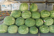 Stall selling fresh watermelons a stack of watermelons on display