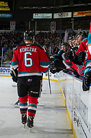 KELOWNA, BC - NOVEMBER 16:  Kaedan Korczak #6 of the Kelowna Rockets fist bumps players on the bench to celebrate a goal against the Kamloops Blazers at Prospera Place on November 16, 2019 in Kelowna, Canada. Korczak was selected in the 2019 NHL entry draft by the Las Vegas Golden Knights. (Photo by Marissa Baecker/Shoot the Breeze)