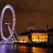 London Eye (Millenium Wheel) at night with the River Thames. High resolution panorama.