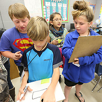 Chris Galabiz, fron left, and Katie Coffey, right, try and draw shapes by only using instructions given to them by their teammates, Cameron Abbott, back left, and Julia Gray during Wednesday's math/science bootcamp held at North Pontotoc Elementary School.