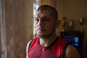 Dagestani local Khabib Nurmagomedov in his home during Ramadan in Makhachkala. Born September 20, 1988 Khabib is a Russian undefeated mixed martial artist. He is a multiple time Combat Sambo World Champion and a Judo black belt who is currently fighting in the lightweight division for the Ultimate Fighting Championship (UFC). He currently holds one of the longest undefeated streaks in MMA with 22 straight wins. He is currently the #3 contender in the UFC Lightweight division and the #3 Lightweight in the world.<br /> <br /> Fighting is embedded in to the culture of Dagestan and it is renowned around the world for producing large numbers of great fighters from wrestlers to mixed martial arts. The Russian government in Moscow also sends large amounts of funding to help train such fighters. <br /> <br /> Located in the North Caucasus, bordering the Caspian Sea and a Republic of Russia, Dagestan is home to almost 3 million mostly muslim people. Ethnically very diverse, it is made up of several dozen ethnic groups and is Russia's most heterogeneous republic, where no ethnicity forms a majority.<br /> <br /> From 2000 until late 2012 Dagestan was subject to a violent Islamic separatist movement that spilled over from neighbouring Chechnya but has now been largely controlled by the Russian Government.